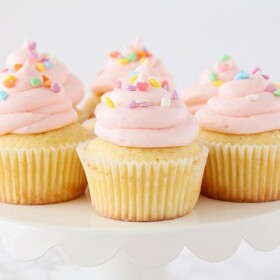 white cupcakes with pink frosting