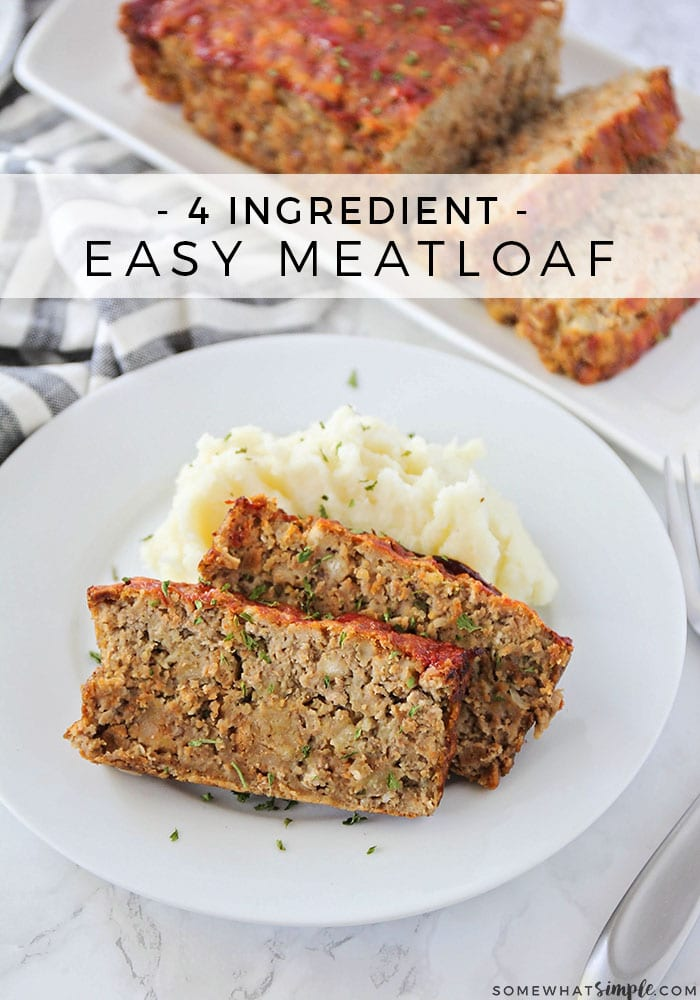 looking down on a white plate with two slices of meatloaf made with this easy recipe and a side of mashed potatoes. A loaf on a serving tray is in the background.