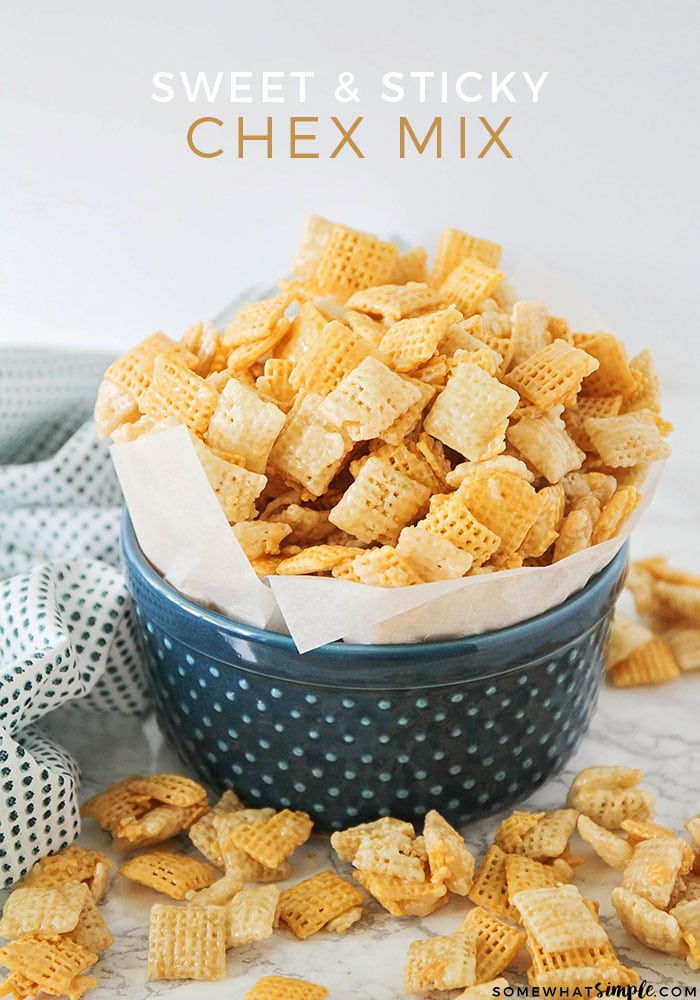 a blue bowl filled with sweet Chex mix made using this recipe