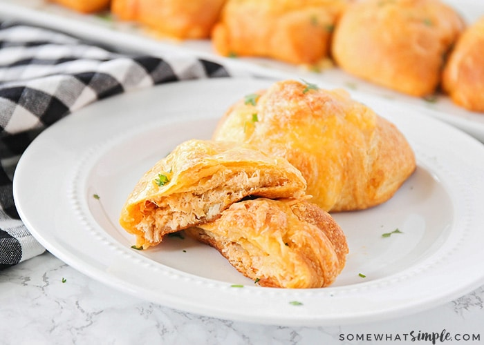 These delicious and savory chicken enchilada puffs are the perfect easy meal! They're stuffed with a cheesy chicken enchilada filling, and taste amazing!