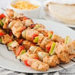 grilled chicken skewers with bell peppers and onions