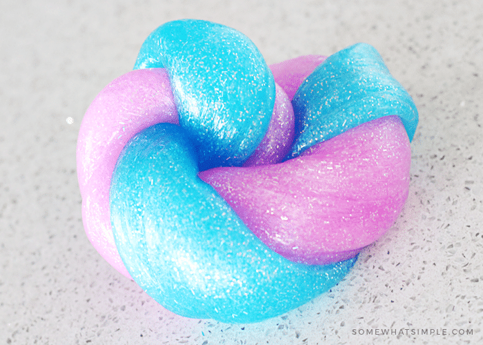 Blue and pink sparkly slime twisted together made with this easy homemade slime recipe.
