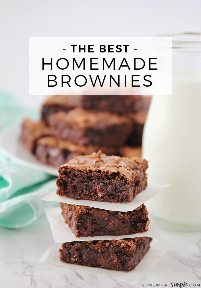 a stack of homemade brownies using this easy recipe with a glass jar of milk and another full plate of brownies in the background