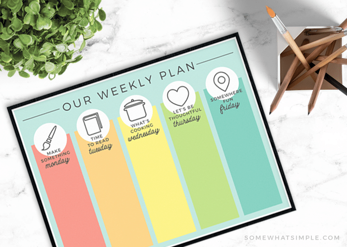 looking down on a multi-colored daily summer schedule free printable template