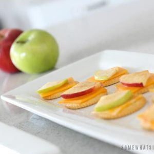 a tray with Apple Cracker and cheese snacks Snacks