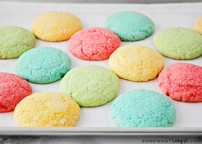 a baking sheet of colorful red, blue, yellow and green cookies made with Jello using this easy recipe