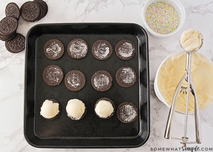 Oreos, ice cream and sprinkles on a counter