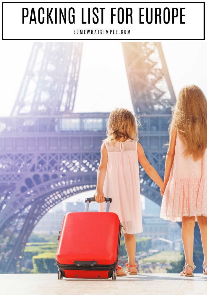 two young girls looking at the eiffel tower. At the top of the image the words packing list for europe is written in black letters.