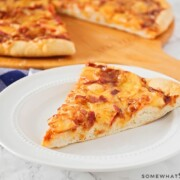 a slice of Homemade Apple Cheddar Bacon Pizza