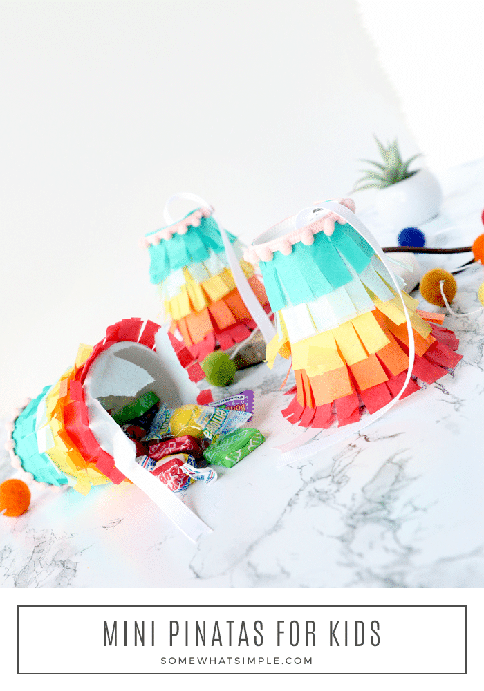 These homemade mini pinatas are an easy craft to make with your kids that are just as much fun to break open as the bigger ones.  Made using a few simple materials that are easy to find, these DIY pinatas are perfect for any celebration! #minipinatas #smallpinatas #diyminipinatas #cincodemayocraft #pinataideas via @somewhatsimple