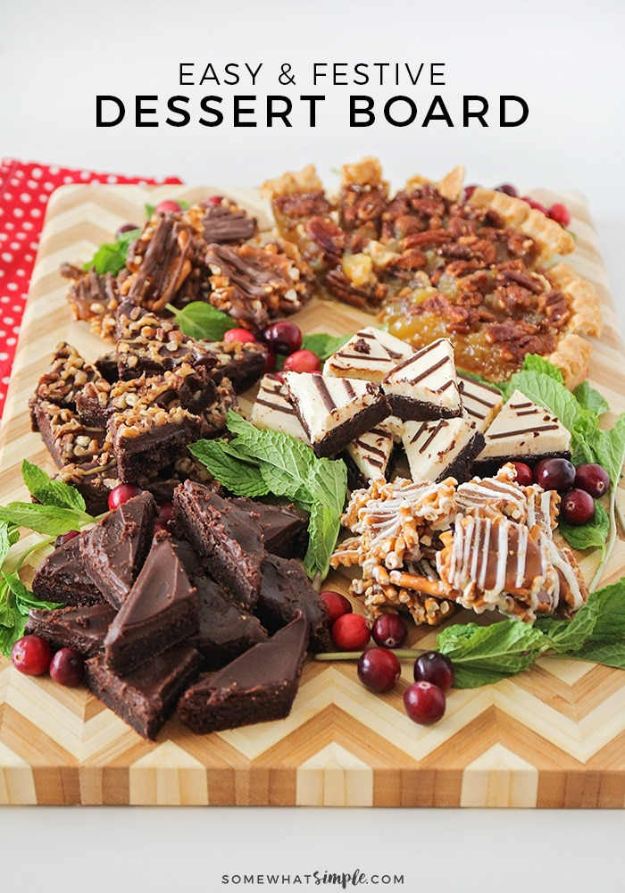 a holiday dessert board filled with tasty treats