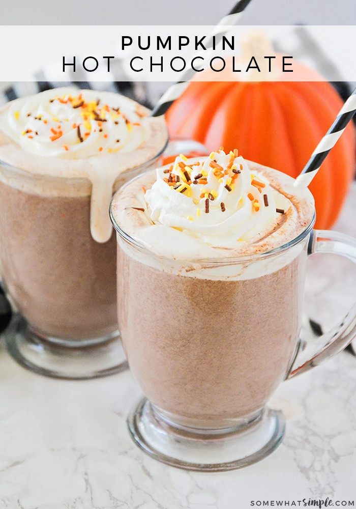 a close up of two glasses of pumpkin hot choclate