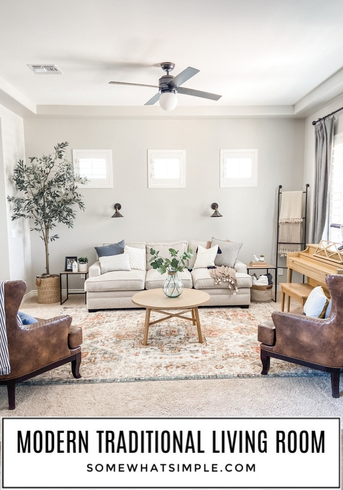The BIG REVEAL of our Modern Traditional Living Room that went from heavy and over-crowded to bright and fresh! #livingroom #decor #update #reveal #refresh via @somewhatsimple