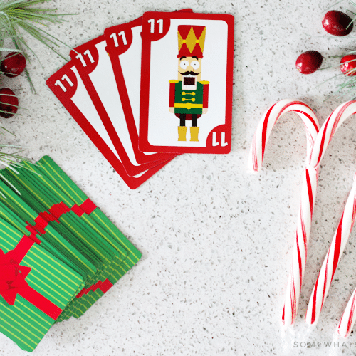 looking down on a deck of cards and candy canes which are used to play this fun variation of the spoons card game.