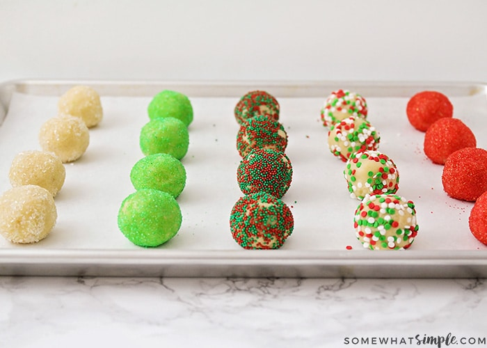 balls of sugar cookie dough that have been rolled in Christmas decorations