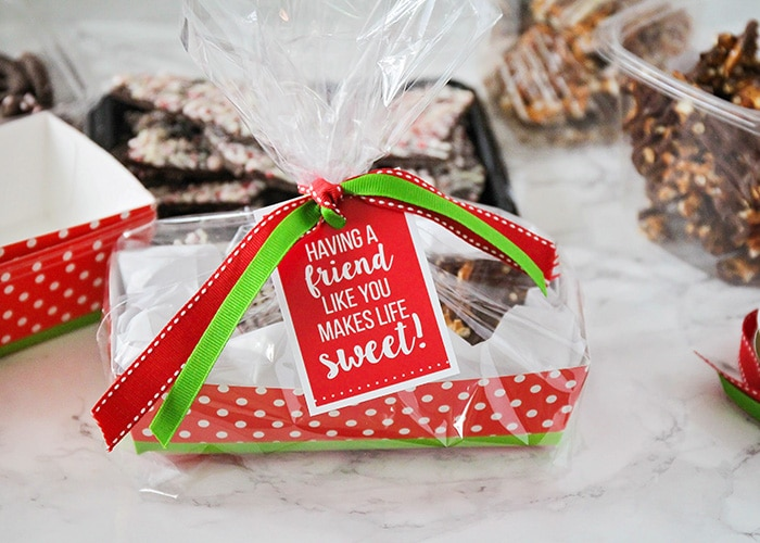 a christmas gift basket wrapped with a printable tag