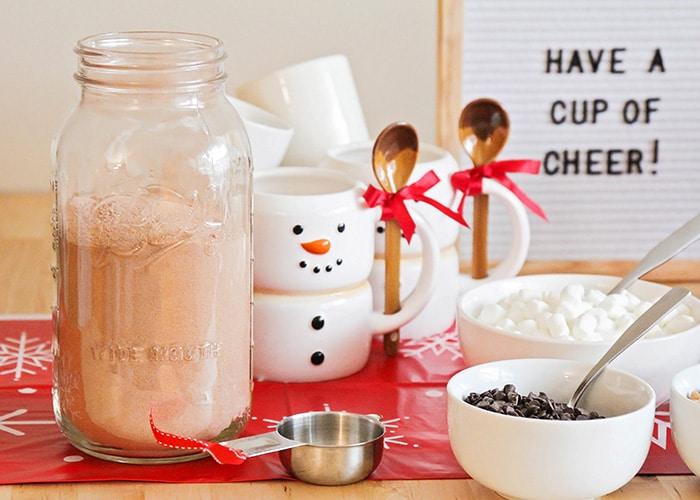 a snowman mug and a jar of hot chocolate mix