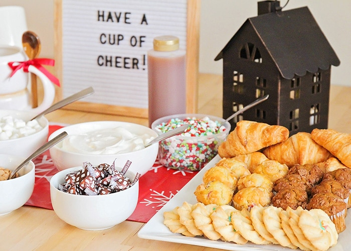 toppings and cookies that are part of a hot cocoa bar
