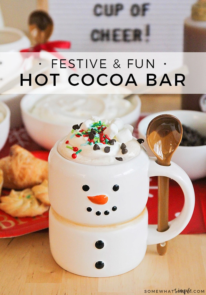 This sweet hot cocoa bar is a fun way to celebrate the season! Set out mix-ins, serve treats on the side, and enjoy a cup of holiday cheer! #hotcocoabar #hotchocolatebar #hotcocoabaridea #hotchocolate #hotchocolatebarforchristmas via @somewhatsimple