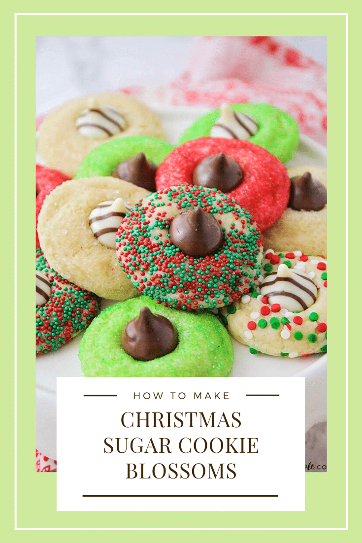These Christmas blossom cookies are a fun and delicious way to spread some holiday cheer!  Made with your favorite sugar cookie dough, Christmas decorations and a Hershey's Kiss, these cookies are irresistible! These are so easy, they take only minutes to prepare but look like you've been baking all day! via @somewhatsimple