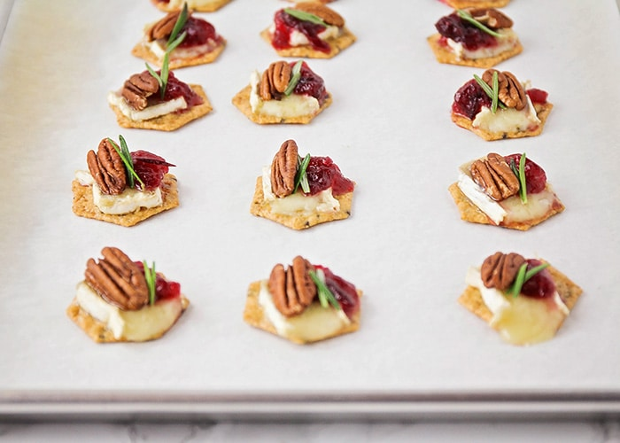 These cranberry brie appetizer bites are super flavorful, and so quick to make. They're a festive and delicious holiday appetizer!