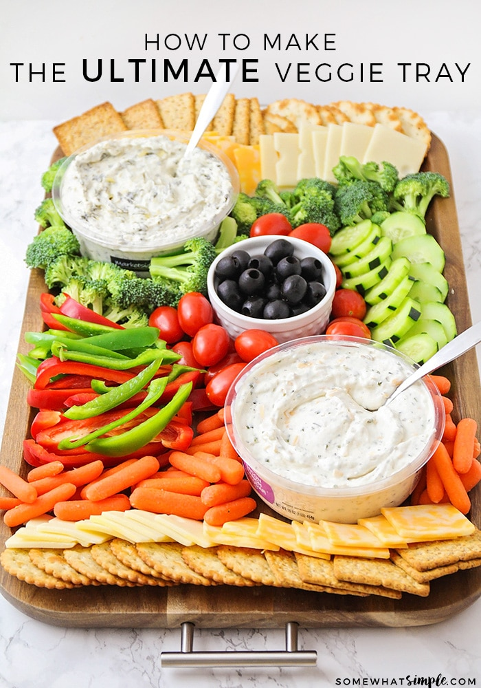 Impress your guests with this beautiful, festive and healthy veggie tray!  This savory appetizer is a perfect compliment to any party.  It's quick and easy to put together, and there's something for everyone to enjoy! #vegetables #vegetabletrayideas #veggietrayideas #vegetabletraydisplay #veggieplatter #veggietray via @somewhatsimple