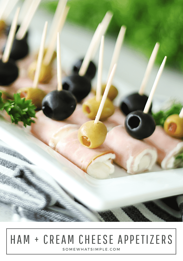 these ham and cheese roll ups with olives on a white plate are an easy appetizer idea