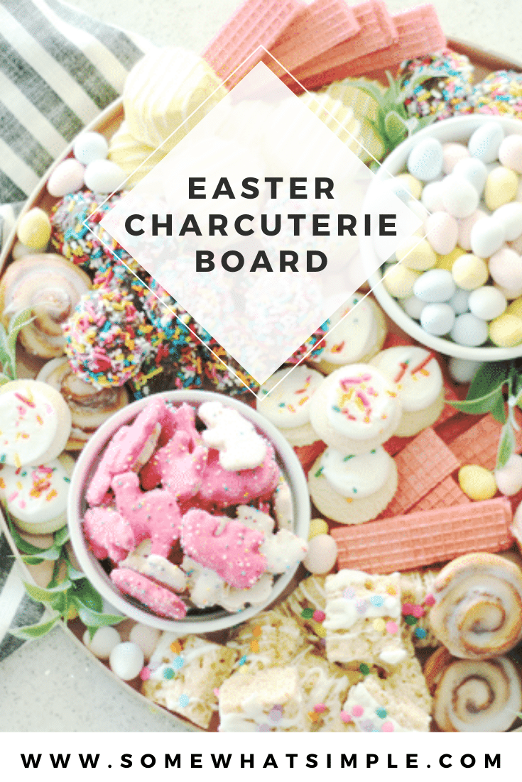 Piled high with cookies, baked goods and candies, this cookie charcuterie board is a beautiful way to serve dessert at your next celebration! Fill the tray with pastel colored cookies that are perfect for Easter or change it up to fit any occasion. #charcuterie #dessertcharcuterie #cookies #platter #party #food via @somewhatsimple