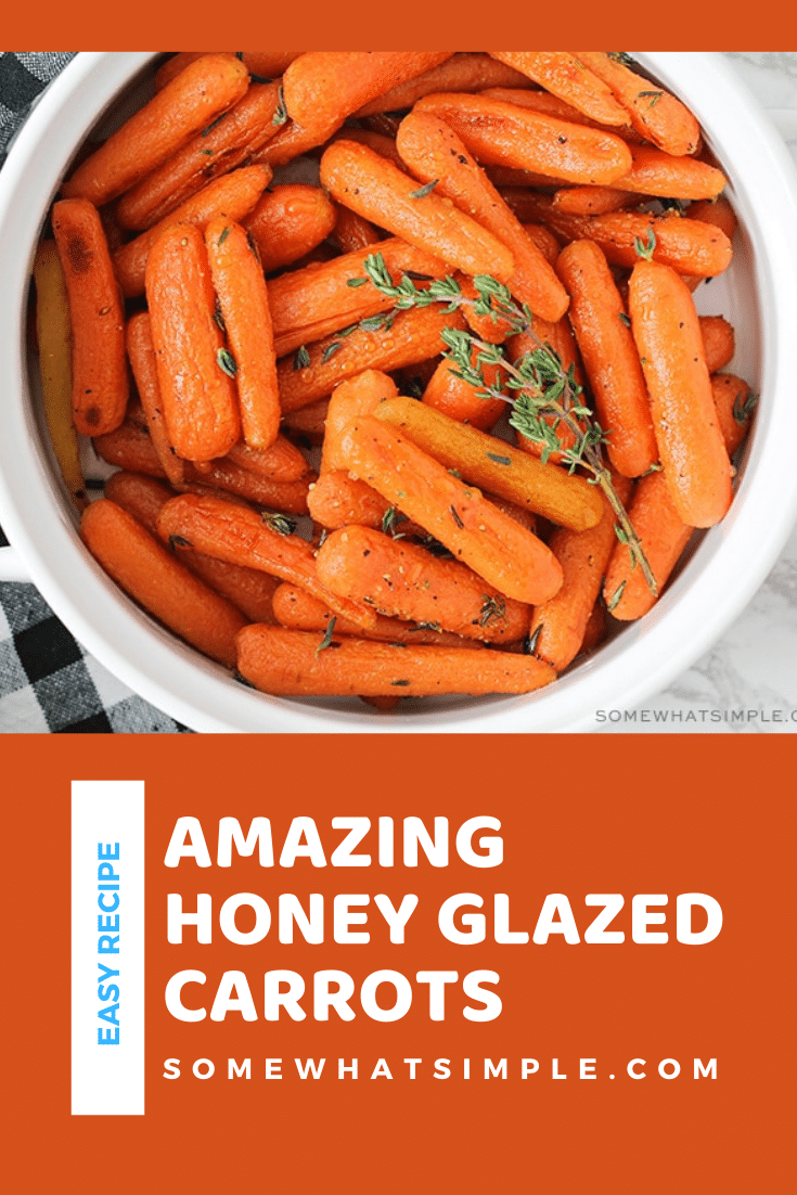 Honey glazed carrots make a simple side dish that is delicious, healthy, and so easy to make!  Drizzle these roasted carrots in a honey and olive oil glaze that will make them irresistibly sweet! These are the perfect side dish for your holiday dinner or just something different any day of the week. via @somewhatsimple