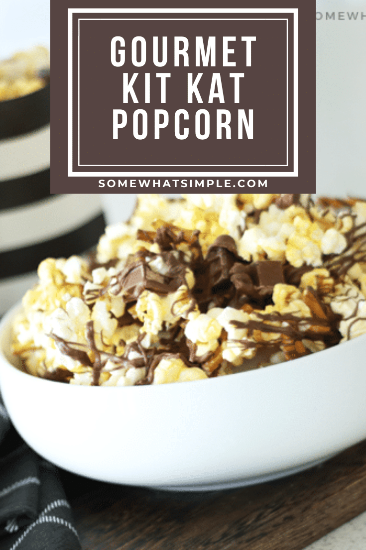 This gourmet Kit Kat popcorn recipe is full of pretzels, candy bars, melted chocolate and buttery popcorn! It is the perfect combination of salty and sweet and is definitely the ultimate snack in a bowl. #gourmetpopcornrecipe #homemadegourmetpopcorn #kitkat #gourmetpopcorn #movienight #gourmetpopcornrecipe via @somewhatsimple