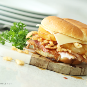 a Hawaiian ham sandwich filled with baked ham, fried onion strips, a slice of pineapple, teriyaki sauce and a slice of Swiss cheese.
