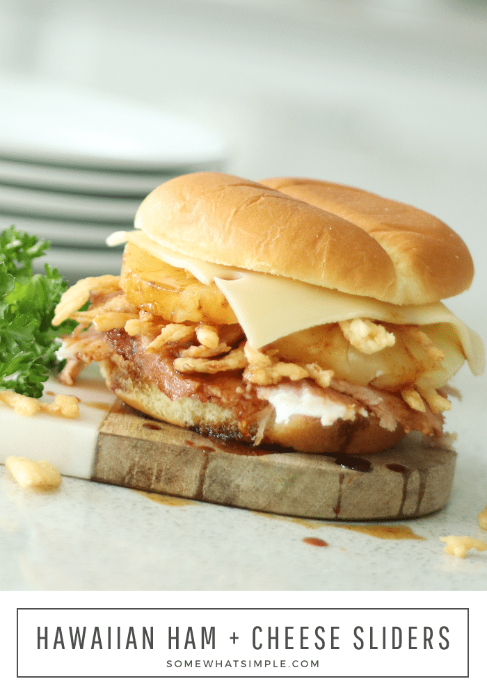 Hawaiian ham sandwiches are made with slices of baked ham and pineapple then topped with fried onions and teriyaki sauce all on a sweet King's Hawaiian roll.  Once you've had one, you'll never eat a ham sandwich any other way.  #hawaiianhamsandwich #hawaiianhamandcheesesandwich #hawaiianrollhamandcheesesliders #hawaiianrollhamsandwich #hamandcheesehawaiianrolls via @somewhatsimple