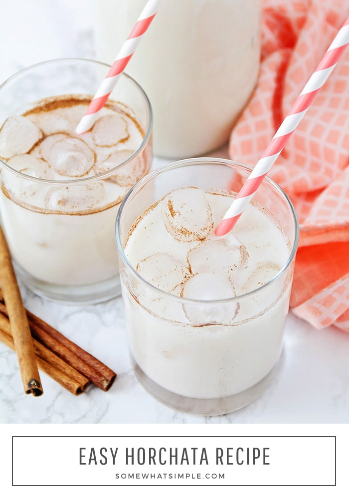 a close up of two glasses filled with the Mexican drink horchata that is made with milk, rice and cinnamon. At the bottom of the image the words easy horchata recipe are written in a white box.