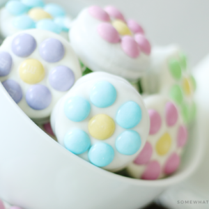 white chocolate covered Oreos with m&ms in a bowl
