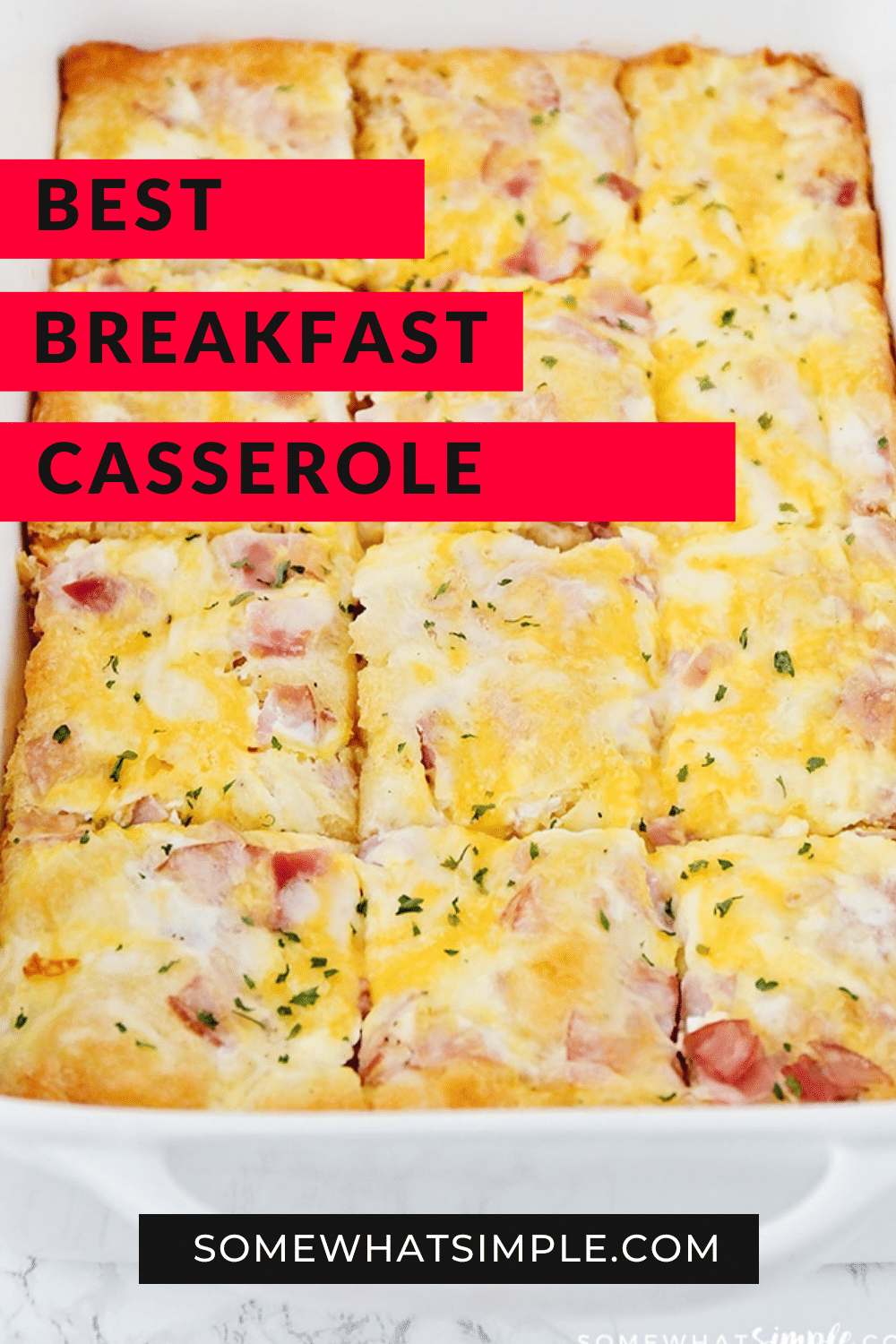 This easy croissant breakfast egg casserole recipe is an easy recipe that is perfect for either breakfast or dinner! Made with eggs, ham (or sausage) and melted cheese baked over a croissant crust that is a perfect way to start the morning! Plus, it only takes minutes to prepare, so you'll have a delicious breakfast in no time! via @somewhatsimple