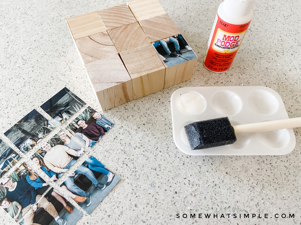 adding mod podge and pictures to a wood block