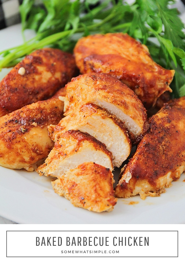 a close up of a plate of oven baked barbecue chicken breasts on a white plate. One of the breasts has been sliced into bite-sized pieces. At the bottom of the image the words baked barbecue chicken is written in a white box.