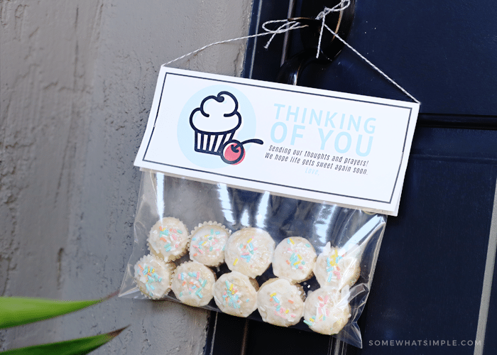 ten mini cupcakes in a plastic bag with a thinking of you tag hanging from the door make a perfect cupcake gift