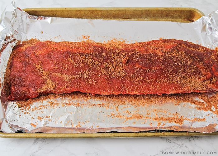 a full rack of ribs covered in a homemade seasoning rub