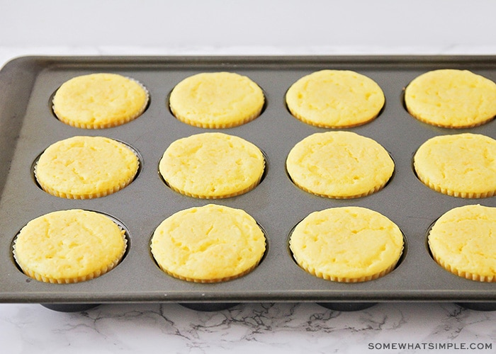 baked yellow lemon cupcakes fresh out of the oven in a cupcake pan