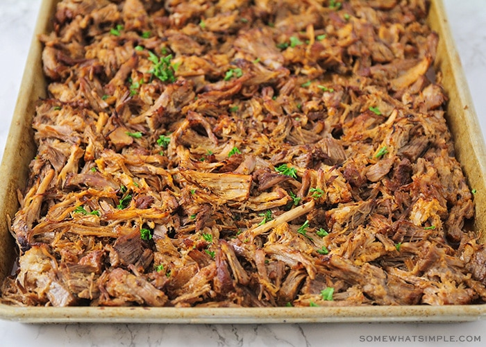 a sheet filled with shredded pulled pork