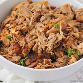 a bowl filled with shredded pulled pork that was made in an instant pot