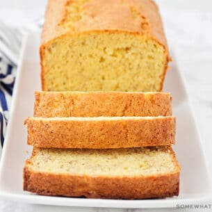 a loaf of banana bread made using cake mix with three slices cut off the end of the loaf