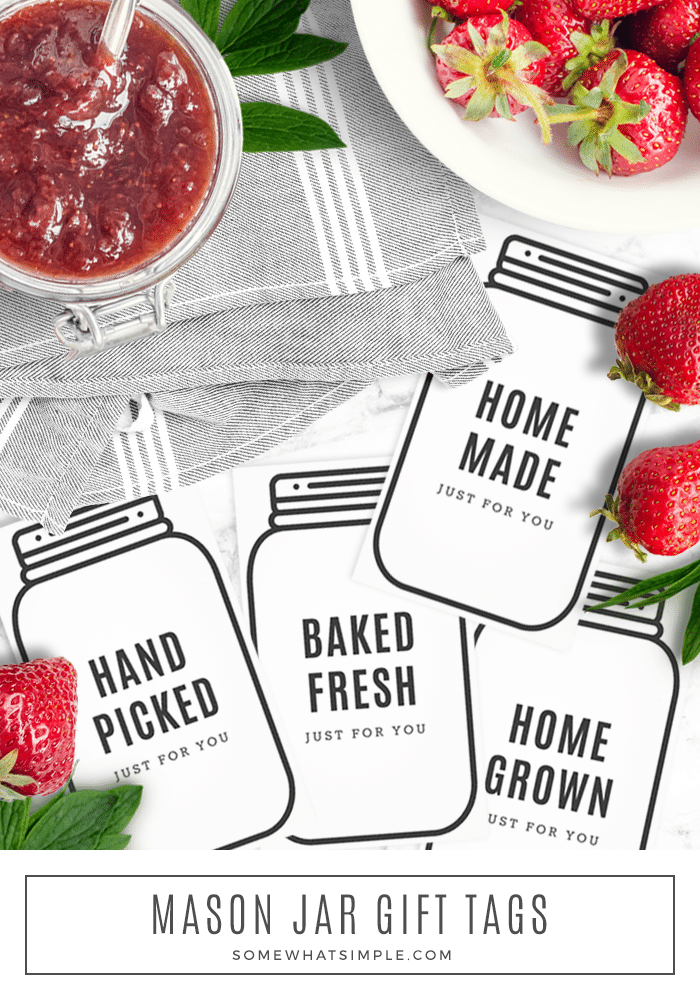 printable mason jar tags laying next to strawberries and fruit jelly