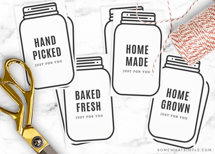 gift tags in the shape of mason jars cut out from this free printable and laid on the counter