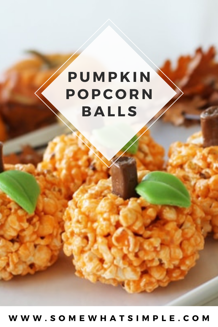 These simple and easy Halloween pumpkin popcorn balls are a fun Halloween treat that are perfect for any party and the kids will absolutely love them! Made with popcorn, jello and small pieces of candy, they couldn't be any easier to make! via @somewhatsimple
