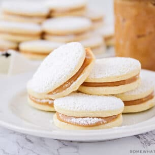 homemade alfajore cookies on a white plate made using this easy recipe