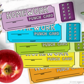 looking down on a purple, blue, green, yellow and orange homework punch card that can also be used as a bookmark