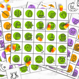 colorful Halloween bingo cards with candy corns being used as a game piece