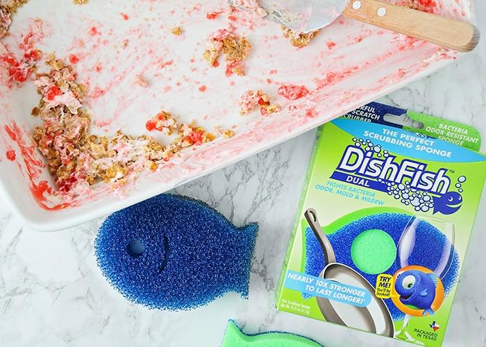 a dirty pan next to a sponge